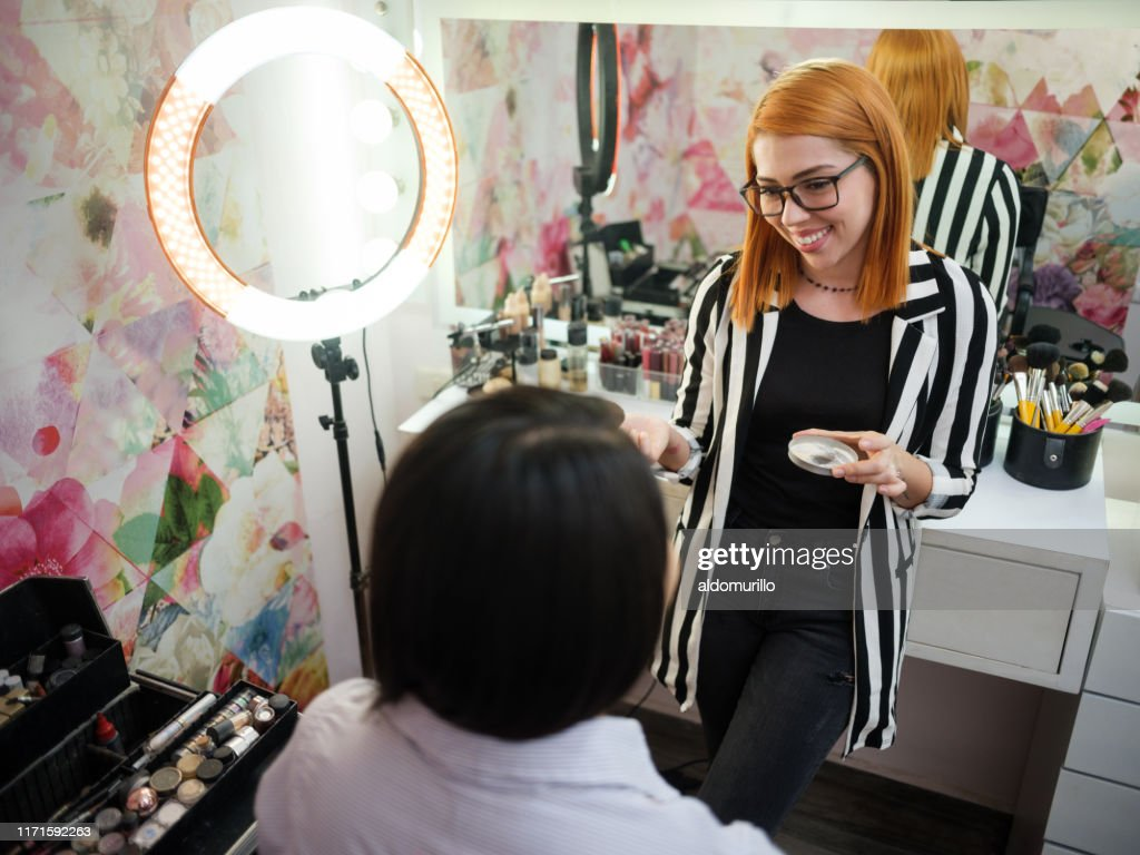 Young Latin Makeup Artist Smiling At Client In Beauty Salon High Res Stock Photo Getty Images