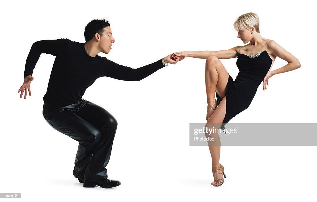 young latin male and young caucasian blonde female dance partners tango dressed in black : Foto de stock