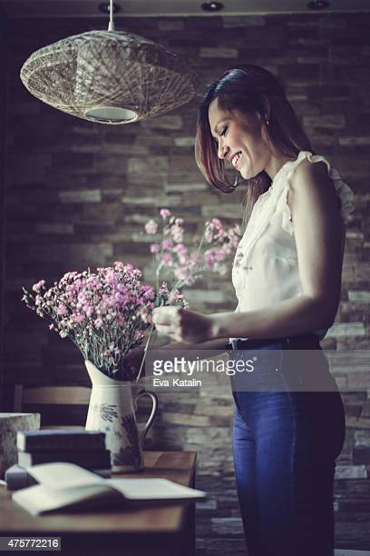 Young Latin woman arranging flowers