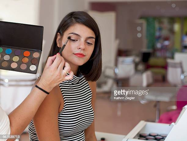 young Latin woman having her makeup done