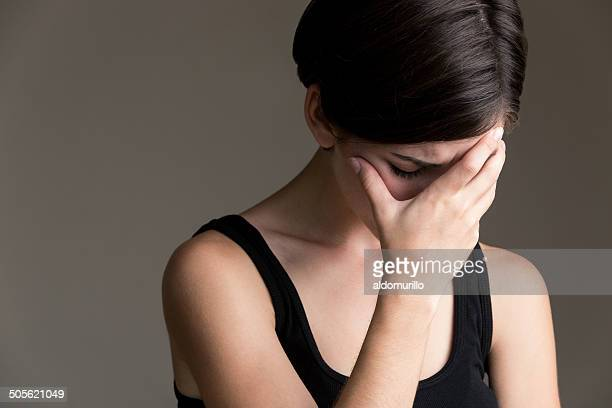 Young latin woman lamenting