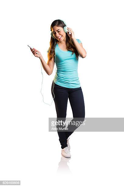 Young latin woman listening to music
