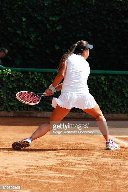 A young latin woman plays tennis in Mexico City - backhand