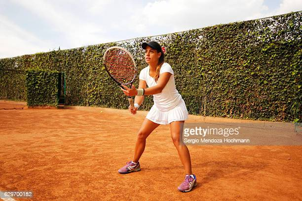 A young latin woman poses after playing tennis in Mexico City