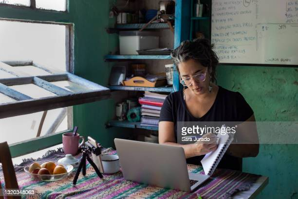 young latina woman working home - aids stock pictures, royalty-free photos & images