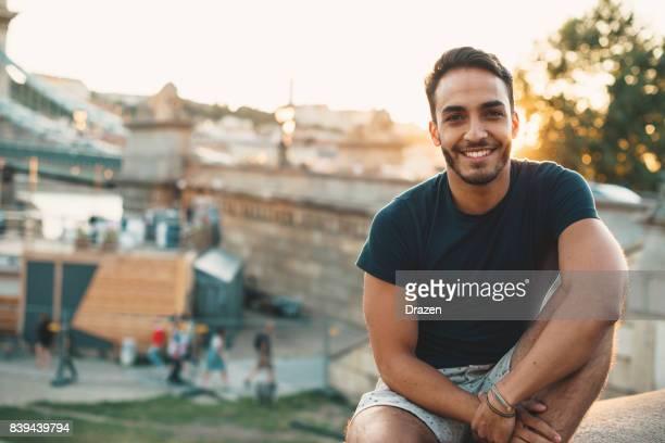 Young Latino man traveling around Europe