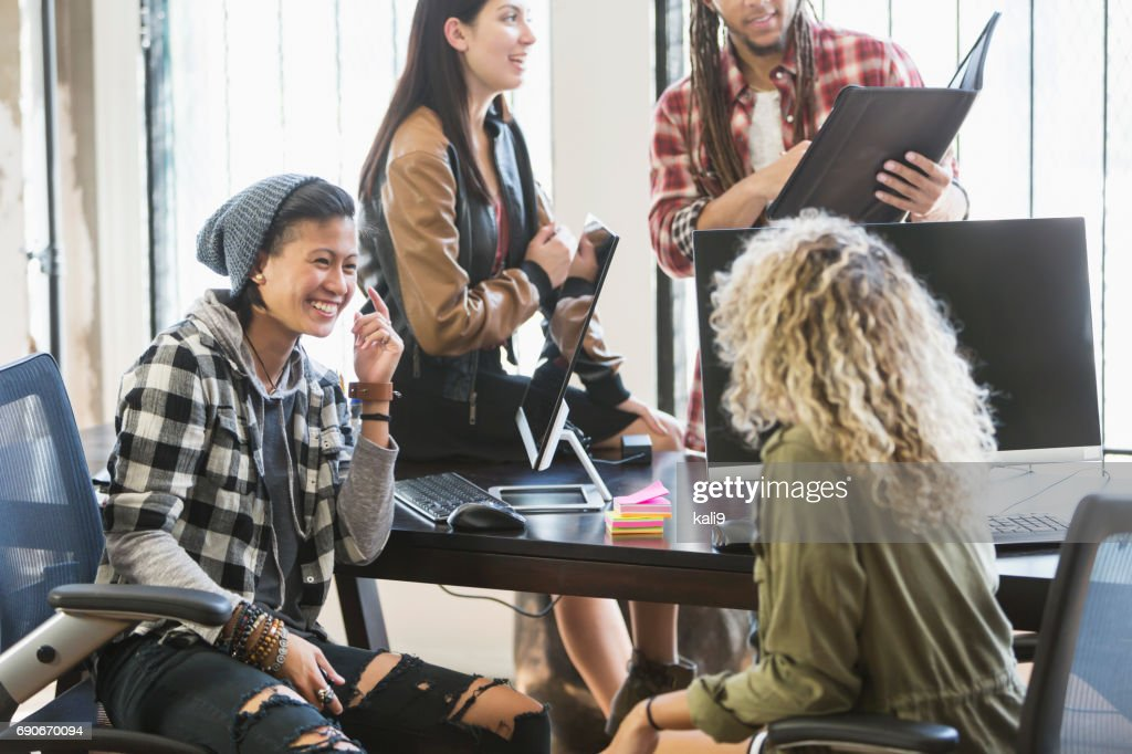Young Latino woman in meeting for startup business : Stock Photo