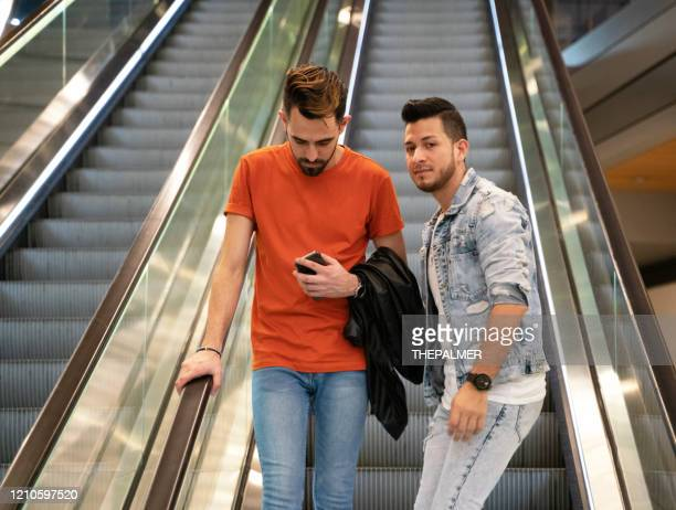 young latinos in mall escalator - puerto rican ethnicity stock pictures, royalty-free photos & images
