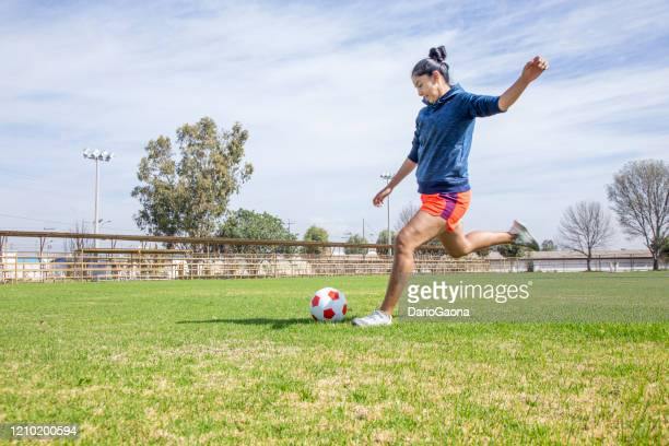 young latinos practicing football - shooting at goal stock pictures, royalty-free photos & images