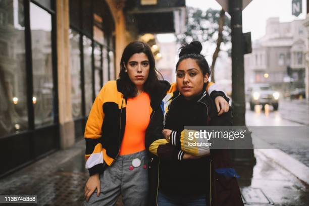 young latinx women in downtown los angeles - candid stock pictures, royalty-free photos & images