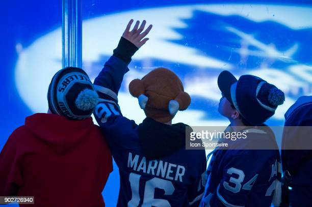 Young Leafs fans watch the lights show before the regular season NHL game between the Vancouver Canucks and the Toronto Maple Leafs on January 6 2018...