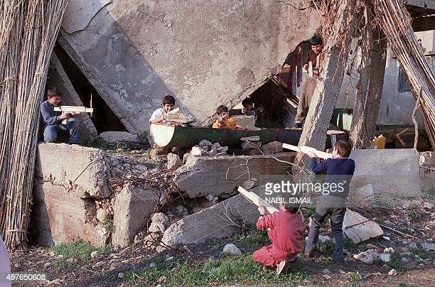 Young Lebanese boys who live on the PortNormandy green line between East and West Beirut play war games with their toy guns 25 January 1989 The...