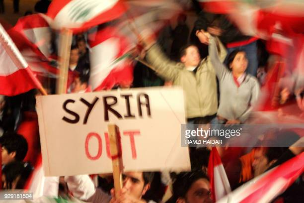Young Lebanese demonstrators wave national flags and banners 04 March 2005 calling for Syrian army withdrawal during an openended protest in Martyrs'...