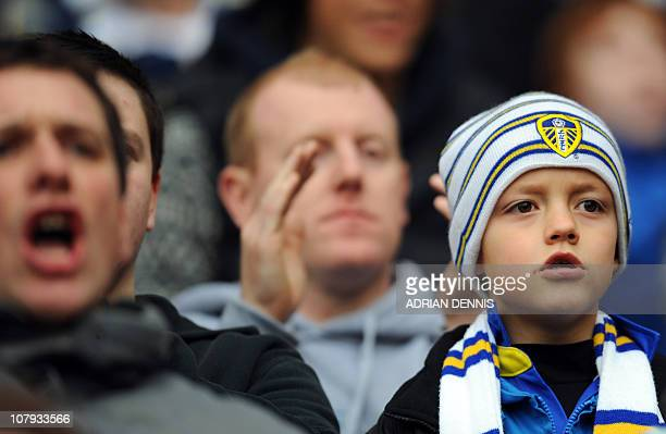 A young Leeds United supporter watches the FA Cup third round football match between Arsenal and Leeds United at The Emirates Stadium north London...