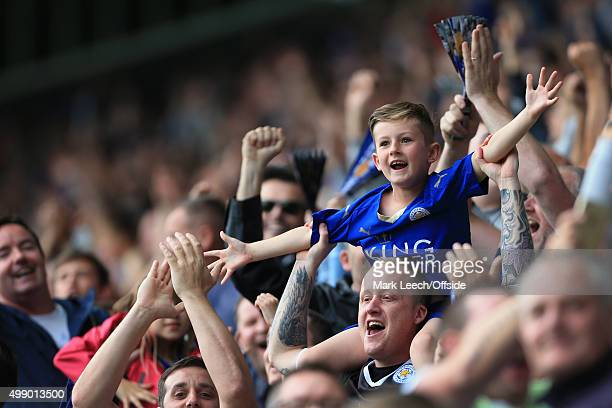 A young Leicester fan celebrates his side's victory at the end of the Barclays Premier League match between Leicester City and Aston Villa at the...