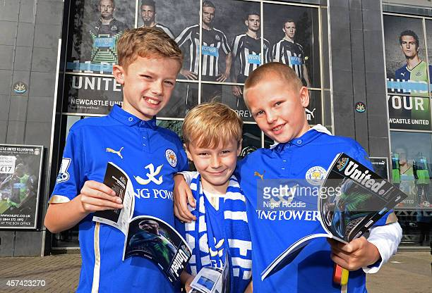 Young Leicester fans arrive at the stadium prior to kickoff during the Barclays Premier League match between Newcastle United and Leicester City at...