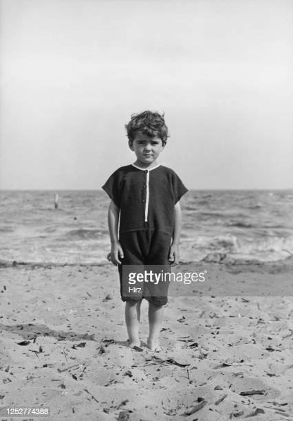 Young Les Graf stands on a beach wearing a onepiece bathing suit circa 1911