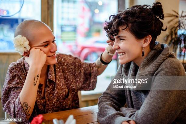young lesbian couple. - love at first sight stock pictures, royalty-free photos & images