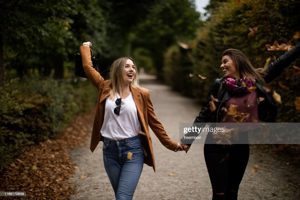 Young lesbian couple walking in park : Stock Photo