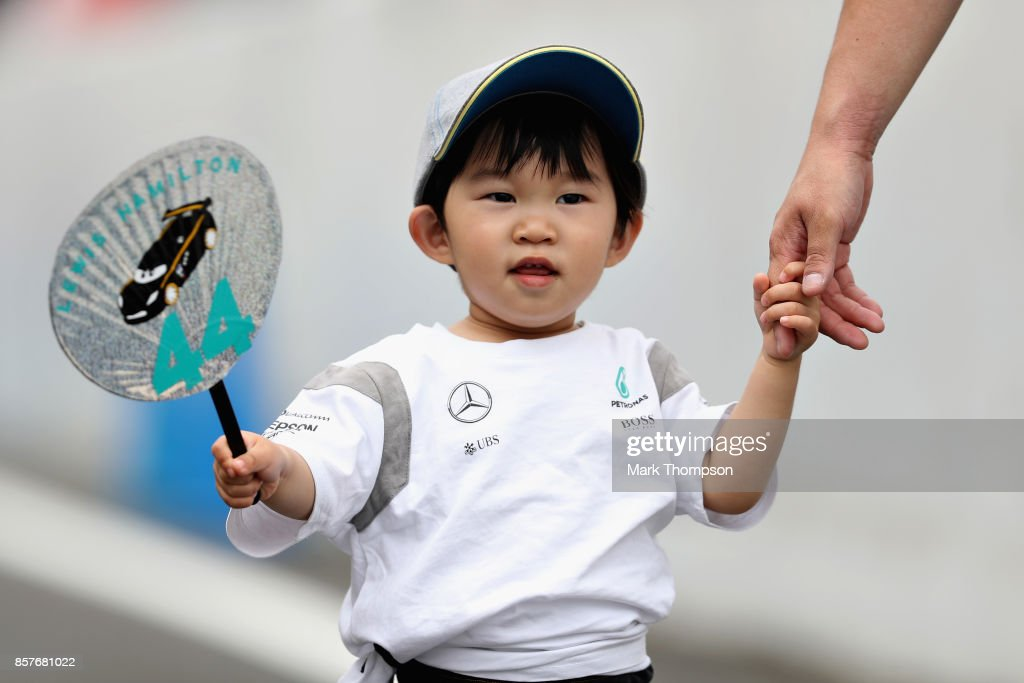 A young Lewis Hamilton of Great Britain and Mercedes GP fan during previews ahead of the Formula One Grand Prix of Japan at Suzuka Circuit on October 5, 2017 in Suzuka.