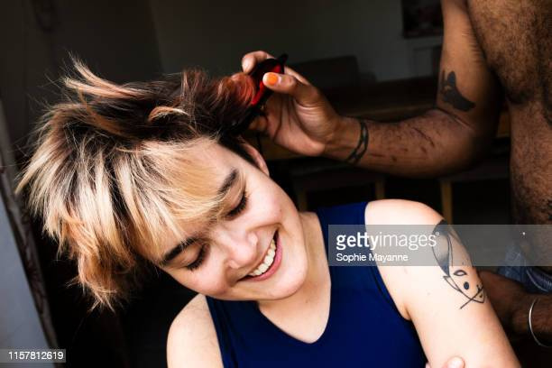 A young LGBT couple head shaving