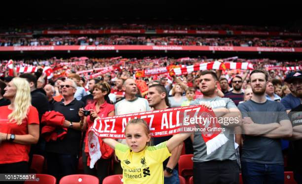 A young Liverpool fan looks on ahead of the Premier League match between Liverpool FC and West Ham United at Anfield on August 12 2018 in Liverpool...