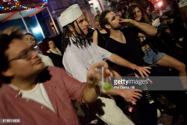 Young local band New Thousand with rapper Ray Wimley busking playing in the street on Frenchman Street with a young crowd loving the vibes and...