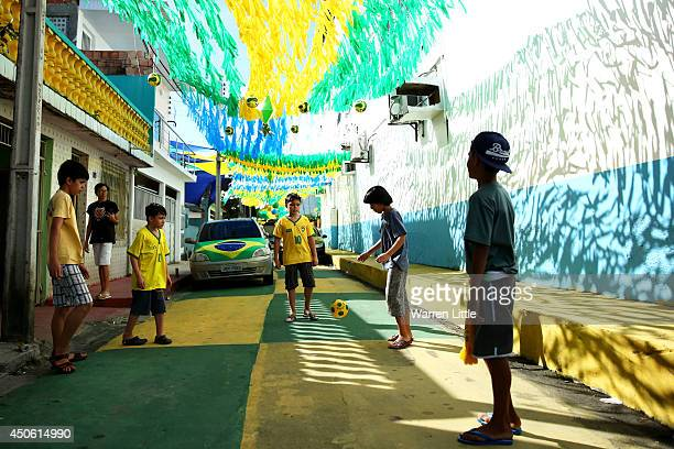 Young local boys play football in the street prior to the 2014 FIFA World Cup Brazil Group D match between England and Italy at Arena Amazonia on...