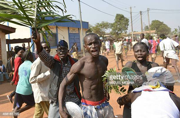 Young local residents take part in a demonstration in the streets of the Combattant neighborhood in Bangui on December 20 calling for the resignation...