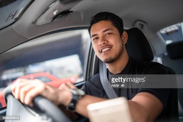 Young Local taxi driver in Kuala Lumpur, Malaysia.