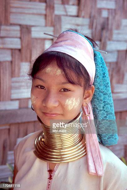 A young Longneck girl put brass rings around their necks in the belief it makes them more beautiful distorts the growth of the collarbone and makes...