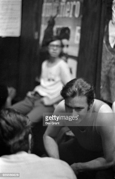 Young Lords Party member David Perez speaks with an unidentified member of the Young Patriots Organization as they attend a Rainbow Coalition meeting...