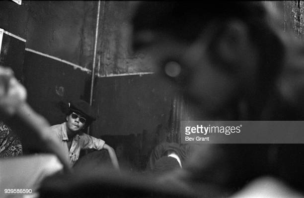 Young Lords Party member Pablo Yoruba Guzman attends a Rainbow Coalition meeting at the YLP office New York New York June 7 1969 The man at fore...