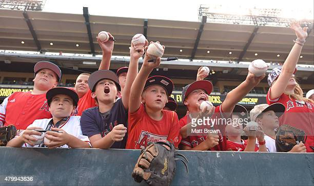 Young Los Angeles Angels of Anaheim fans call to a player for an autograph before the game against the New York Yankees at Angel Stadium of Anaheim...