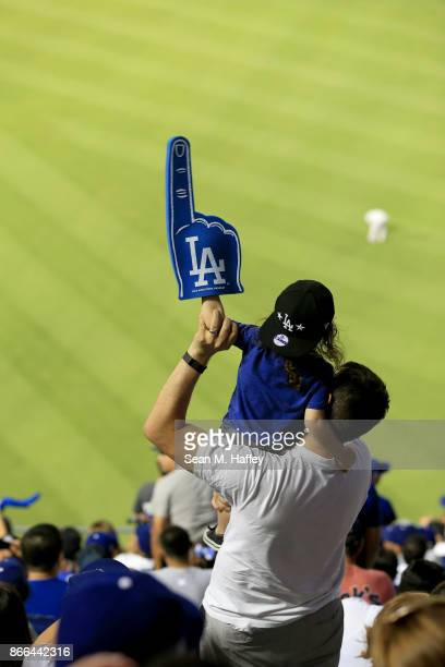 A young Los Angeles Dodgers fan holds up a foam finger during game two of the 2017 World Series between the Houston Astros and the Los Angeles...