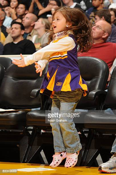A young Los Angeles Lakers fan cheers her team on during the game against the Toronto Raptors at Staples Center on October 19 2008 in Los Angeles...
