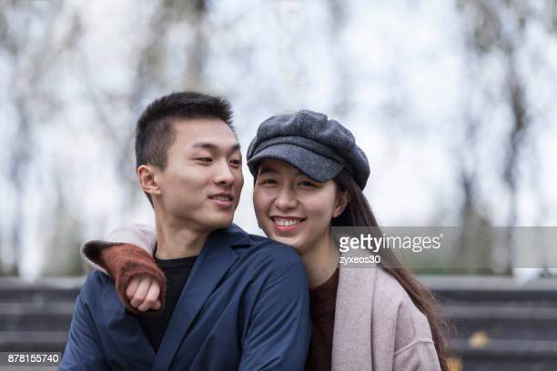 a young lovers close together,east asia,shanghai. - china east asia stock photos and pictures
