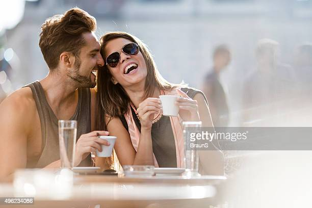 Young loving couple enjoying their day in a cafe.