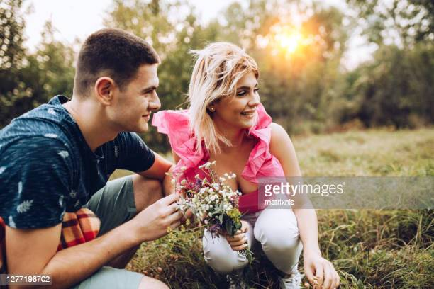 young loving couple in the park - 18 23 months stock pictures, royalty-free photos & images