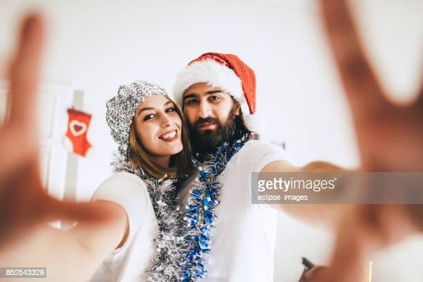 Young loving couple making selfie