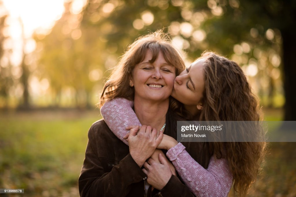 young loving daughter kissing her mother stock photo getty images