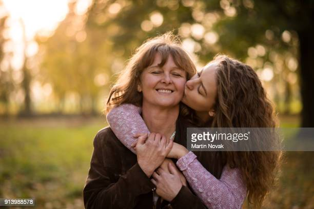 Young loving daughter kissing her mother