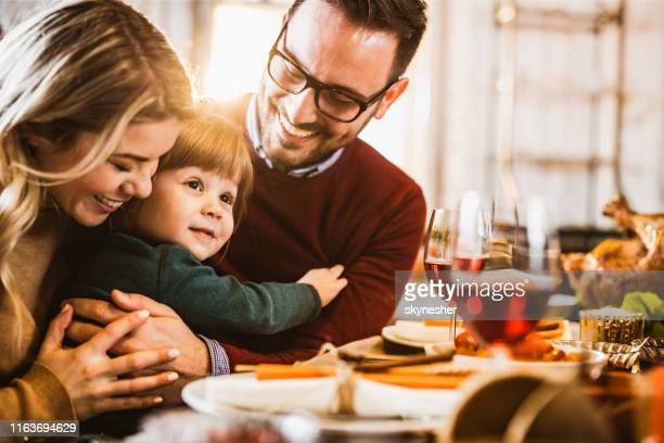 young loving family enjoying in their time at dining table. - kids thanksgiving stock pictures, royalty-free photos & images