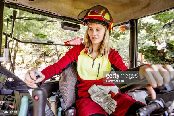 Young Lumberjack Woman Driving a Tractor