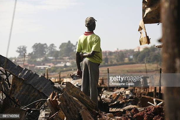A young Luo looks at a burned area of houses belonging to Kikuyus in a Kibera slum