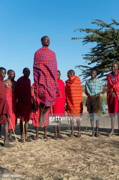 Young Maasai men performing a traditional jumping dance in the Masai Mara in Kenya