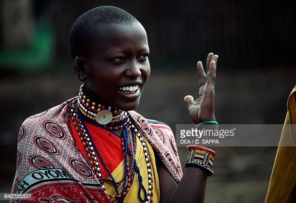 A young Maasai woman wearing typical jewellery Kenya