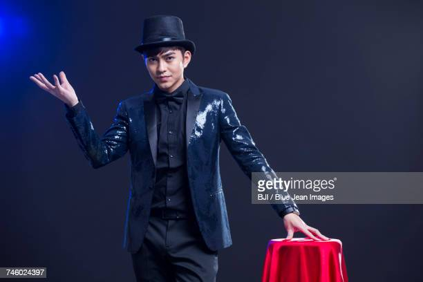 Young magician performing magic trick