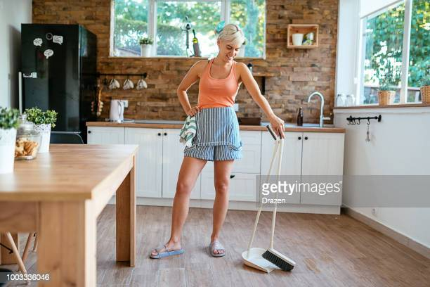 young maid cleaning house floors - tidy room stock pictures, royalty-free photos & images