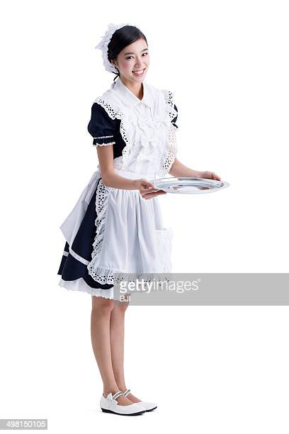 Young maid with silver platter in hand